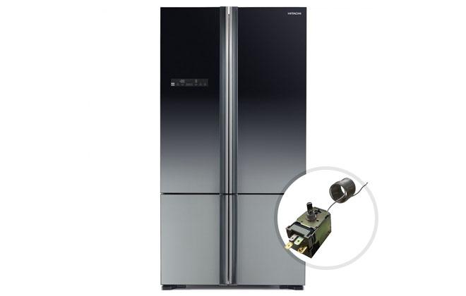 Часть холодильника терморегулятор