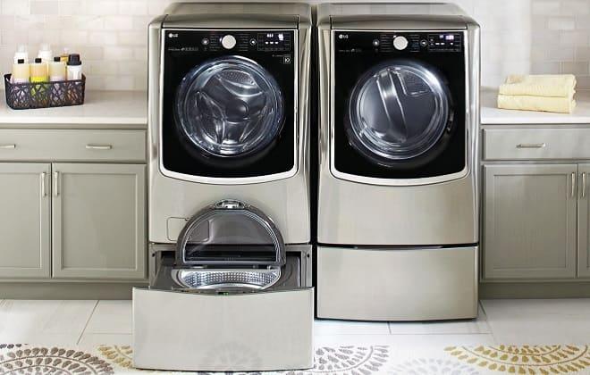 Серая стиральная машина с двумя барабанами