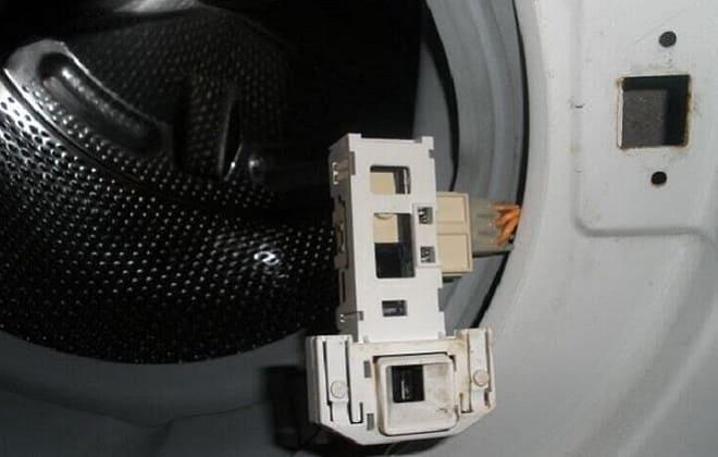 Система блокировки люка стиралки
